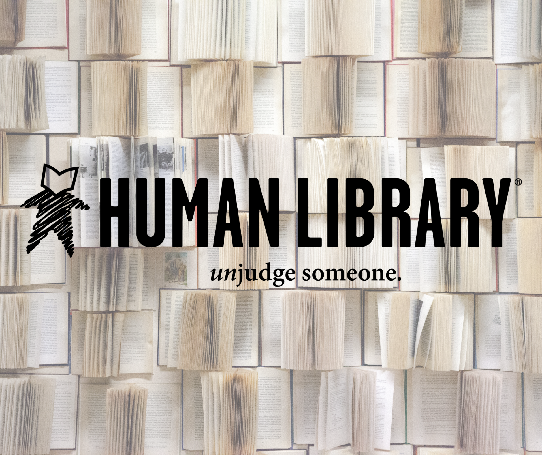 Human library logo over book page background