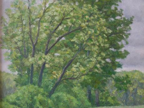 A painting of trees and a field on an overcast day